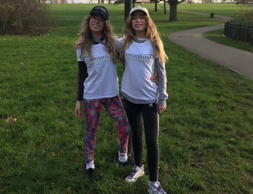 Twins run a half marathon for Womankind!